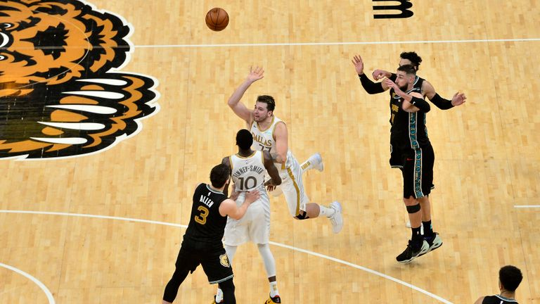 Dallas Mavericks guard Luka Doncic (77) takes the game-winning 3-point shot at the end of the second half of the team's NBA basketball game against the Memphis Grizzlies on Wednesday, April 14, 2021, in Memphis, Tenn. The Mavericks won 114-113. (AP Photo/Brandon Dill)