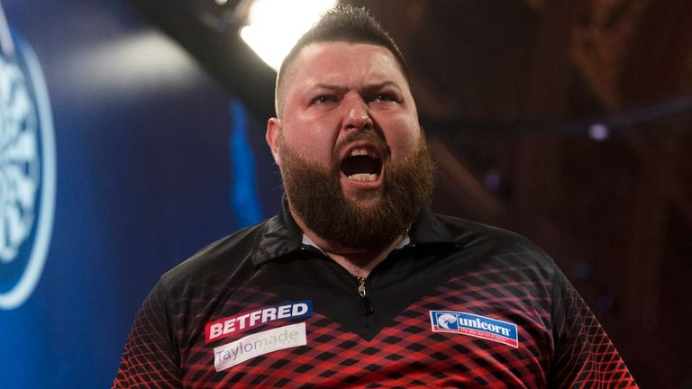 Michael Smith won the battle of the Smiths to beat namesake Ross in the final of Players Championship 27 (Image: Lawrence Lustig/PDC)